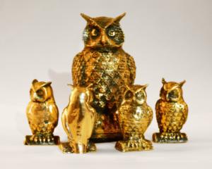 Латунные совы, распечатанные на 3D-принтере